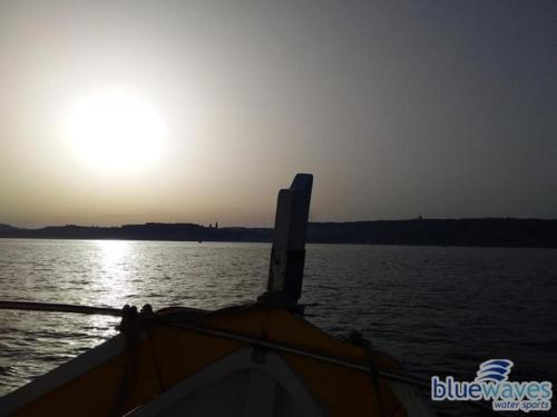Sunset during a traditional luzzu boat trip