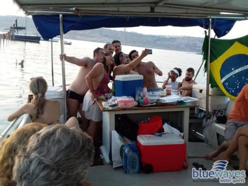 Family and friends on a luzzu boat trip