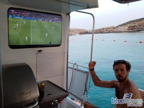 Watching world cup on a luzzu boat trip